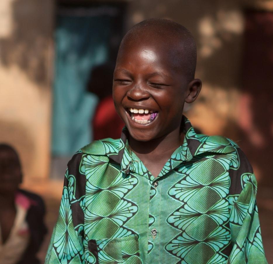 Tjeko uganda smile child glimlach kind skelter berg toys